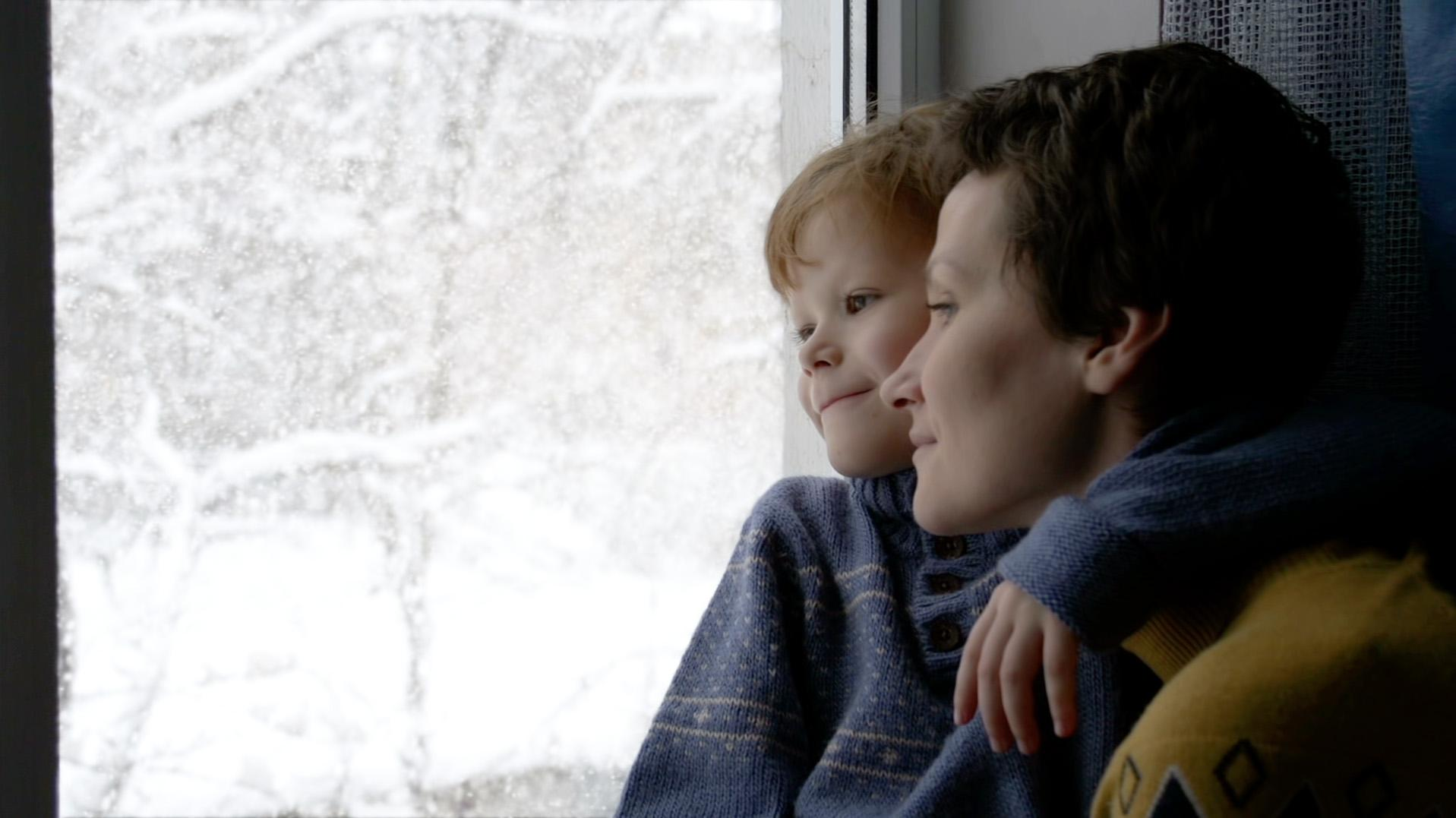 mother and son watching snow